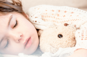 At what age should my child transition from cot to bed?